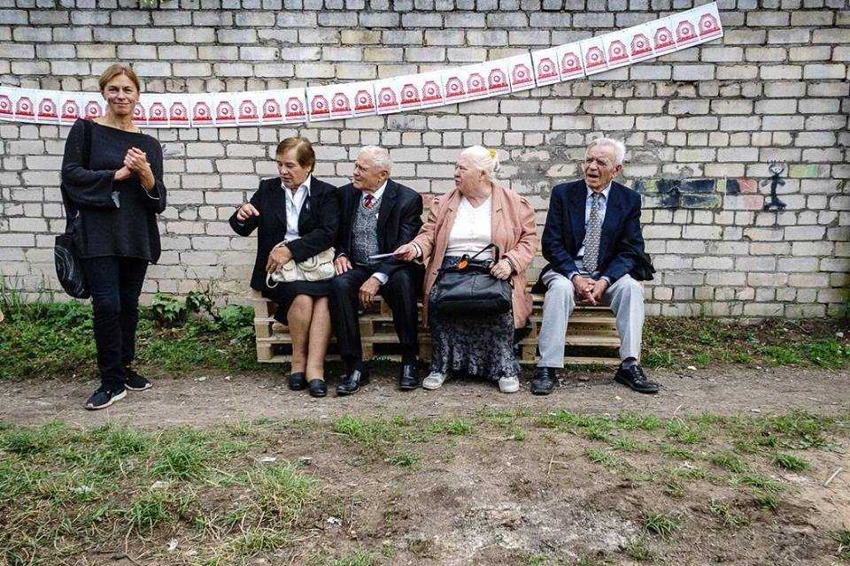 Vita Gelūnienė and local on the opening of Friendly Zone #6 – Cabbage Field, a Site Specific Land Reclamation Project as part of Kaunas Biennial 2015 . Photo: Remigijus Ščerbauskas